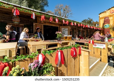 VIENNA, AUSTRIA - SEPTEMBER 28, 2018: People drinking beer during famous traditional Octoberfest (aka Wiener Wiesn-Fest) taking place each year in Vienna, Austria.