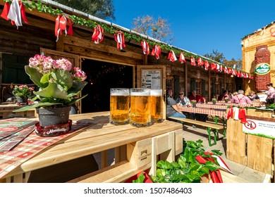 VIENNA, AUSTRIA - SEPTEMBER 28, 2018: People drinking beer during famous traditional Oktoberfest (aka Wiener Wiesn-Fest) taking place each year in Prater park in Vienna, Austria.