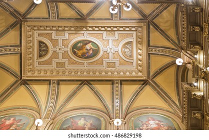 VIENNA, AUSTRIA - September 3, 2016: Detail of the magnificent ceiling above the main stairway at the State Opera in Vienna, Austria