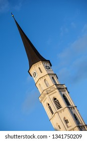 Vienna, Austria - September 4 2013: Spire of St. Michael's Church (Michaelerkirche) on clear blue sky background, Vienna, Austria
