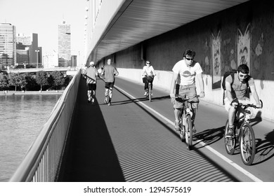 VIENNA, AUSTRIA - SEPTEMBER 6, 2011: Pedestrians walk and cyclists ride in Danube river bridge, Vienna. Vienna is often quoted among most bicycle and pedestrian friendly cities.