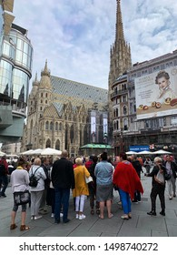 Vienna, Austria - September 6, 2019: crowd of tourists walk through Graben, one of the most famous streets for shopping and old architecture in center of Vienna
