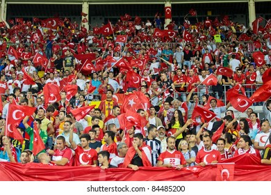 VIENNA,  AUSTRIA - SEPTEMBER 6 Turkish fans during the EURO 2012 soccer game on September 6, 2011 in Vienna, Austria. The game is a draw.