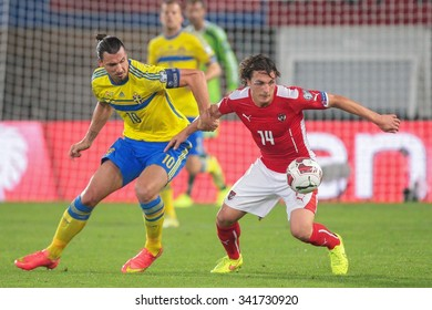 VIENNA, AUSTRIA - SEPTEMBER 9, 2014: Julian Baumgartlinger (#14 Austria) and Zlatan Ibrahimovic (#10 Sweden) fight for the ball in an European Championship qualifying game.