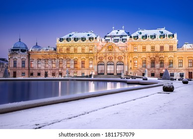 Vienna, Austria. Upper Belvedere snowy winter night reflection, Wien austrian travel background.