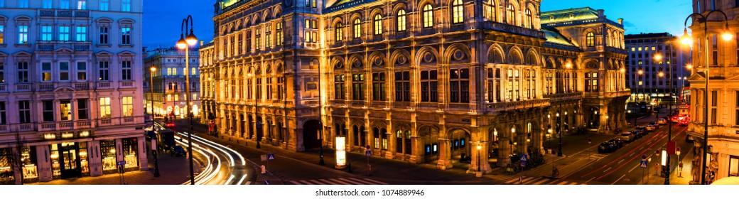 Vienna, Austria. View of State Opera in Vienna, Austria during the night. Bright blue sky, car light trails