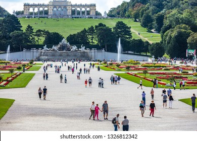 VIENNA, AUSTRIA,SEPTEMBER 8 ,2018: People walking at the gardens of Schonbrunn Palace , a former imperial summer residence of Habsburg monarchs.