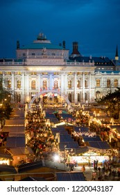 Vienna Christmas Market in front of the Burgtheater and city hall at blue-hour from the Rathaus balcony