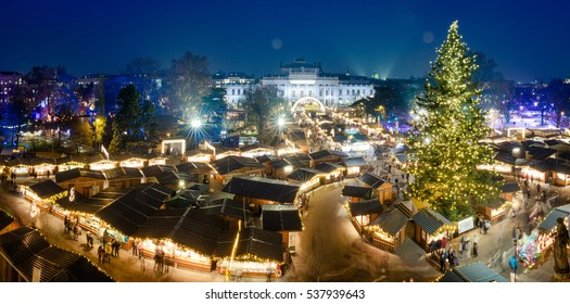 Vienna Christmas Market Panorama at night, aerial view with blue sky. View from the Rathous