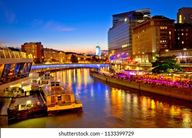 Vienna city modern riverfront evening view, capital of Austria