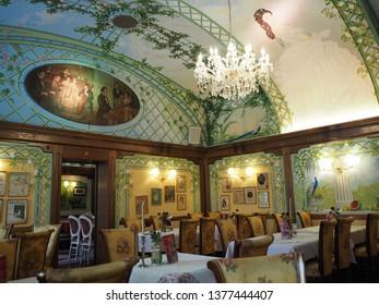 """VIENNA - February 10, 2019: the interior of Restaurant Schönbrunner Stöckl with portraits of """"Sisi"""" & Franz Schubert"""