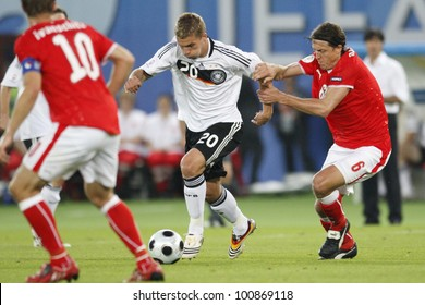 VIENNA - JUNE 16:  Lukas Podolski of Germany controls the ball against Austria's Rene Aufhauser during a UEFA Euro 2008 match June 16, 2008 in Vienna, Austria.  Editorial use only.