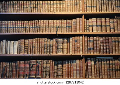 Vienna - March 10 2016: old books on wooden shelf in the national library of Vienna, 10 march 2016, Vienna, Austria.