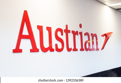 VIENNA, MAY 5, 2019: Austrian airlines logo at Vienna Airport, terminal 3. Austrian is a subsidiary of the Lufthansa Group.