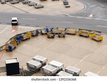 VIENNA, MAY 5, 2019: Empty luggage trolleys and ULD air cargo containers lined up at the Vienna airport. Baggage loading, airport trolley, luggage cart.