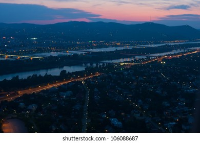 Vienna at night with Danube River & Island (Donauinsel).
