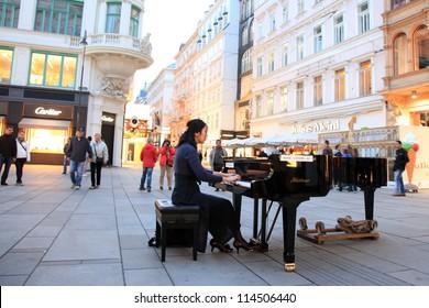 VIENNA - SEPT 23: Talented Pianist Soryang Plays Classical Music at Stefansplatz on September 23, 2012, in Vienna, Austria.