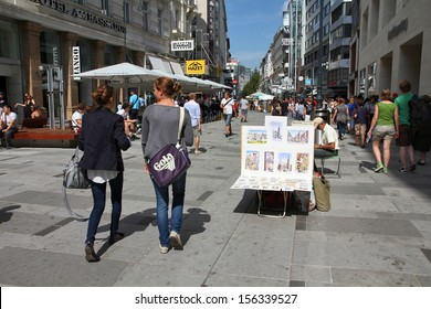 VIENNA - SEPTEMBER 5: People stroll on September 5, 2011 in Karntner Strasse in Vienna. As of 2008, Vienna was the 20th most visited city worldwide (by international visitors).