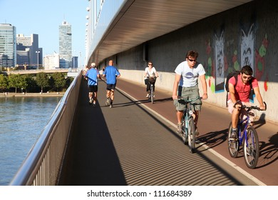 VIENNA - SEPTEMBER 6: Pedestrians walk and cyclists ride on September 6, 2011 in Danube river bridge, Vienna. Vienna is often quoted among most bicycle and pedestrian friendly cities.