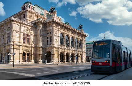 Vienna state opera during sunny day with a tram