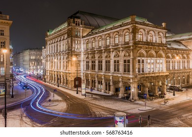 Vienna state opera in the night taken with long exposure, while cars passing by on snow covered streets. January 2017.