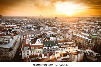 Vienna sunset city skyline as seen from the top of St. Stephan dome. Aerial view of Wien, Austria