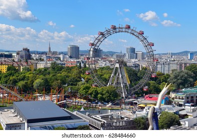 Vienna view. Prater Entertainment Park /Amusement Park with Ferris wheel in foreground, St. Stephen's Cathedral in background.