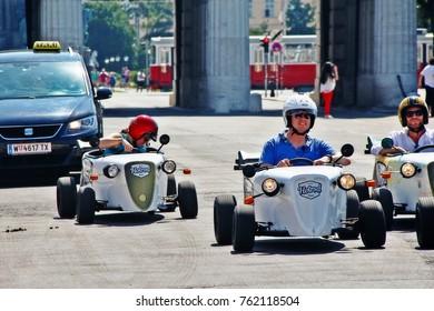 Vienna (Wien), Austria (Osterreich) - June 24, 2017 - The tourists make the city sightseeing tour by the little go karts