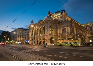 VIENNA/AUSTRIA - 22 SEPTEMBER 2017: Wide shot of traffic passing in front of the Vienna Opera House on Opernring. Taken early evening in September as the city lights are coming on