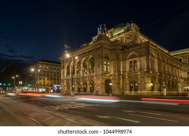 VIENNA/AUSTRIA - 23 SEPTEMBER 2017: Wide shot of traffic passing in front of the Vienna Opera House on Opernring. Taken early evening in September as the city lights are coming on