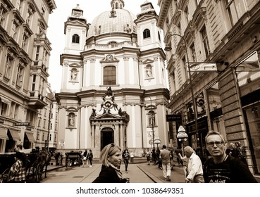 VIENNA,AUSTRIA - SEPTEMBER 3; old-fashioned effect sepia image people surrounded by traditional European architecture with dome St Peter's basilica behind in  street September 3 2017 Vienna Austria