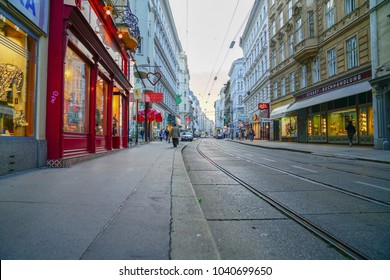 VIENNA,AUSTRIA - SEPTEMBER 5;  Lights, buildings and tram tracks along inner city night streets lined on both sides by commercial buildings September 5 2017 Vienna Austria