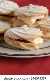 Viennese Whirls a British confection made of a soft butter biscuit piped into a whirl shape filled with buttercream and jam