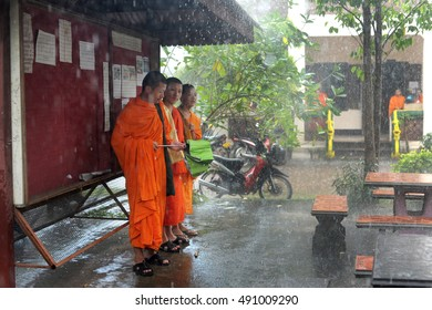 Vientian, Laos july 12, 2013: Buddhist monks in the rain