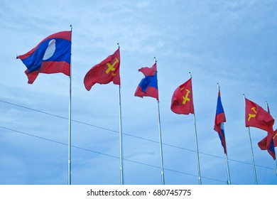 Vientiane Capital: 15 JULY 2017, Laos flag waving on flagstaff with blue sky background