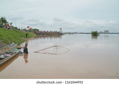 Vientiane Capital, Laos - August 20, 2018: Water in the Mekong River Height to Reach the Redline in Vientiane Capital as of August 20, 2018. Laotian Fishing using Traditional Tool
