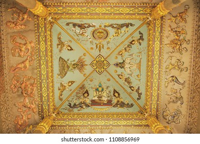 VIENTIANE, LAOS - APRIL 22, 2012: Rich ceiling decoration of the Patuxay Victory monument in Vientiane, Laos.