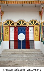 VIENTIANE, LAOS - APRIL 22, 2015 - Lao flag. Graffiti on the door of a Buddhist monastery. Vientiane, Laos