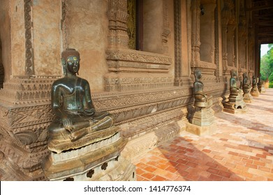 Vientiane, Laos - April 23, 2012: Buddha statues located at the outside wall of the Hor Phra Keo museum building (former temple of the Emerald Buddha) in Vientiane, Laos.