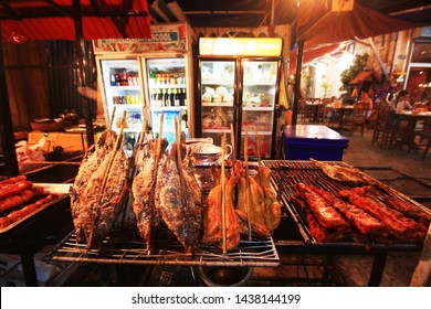 VIENTIANE, LAOS - AUGUST 08, 2015: Grilled fish, grilled chicken on Street food in night market at Laos