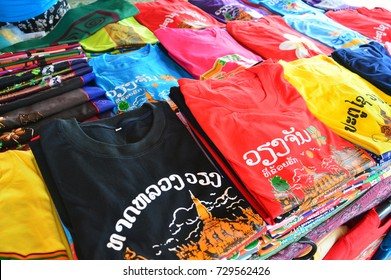 Vientiane, Laos - August 2015: Colorful t-shirts with Lao tourist attractions screen printing sold at souvenir shop in Vientiane, capital city of Lao PDR.