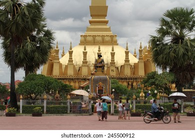 VIENTIANE, LAOS - AUGUST 7: The busy entrance to the Pha That Luang or Grand Stupa in Vientiane, Laos on the 7th August, 2014.