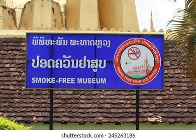 VIENTIANE, LAOS - AUGUST 7: A no smoking sign outside of the Pha That Luang Stupa in Vientiane, Laos on the 7th August, 2014.