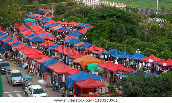 VIENTIANE,  LAOS - CIRCA AUGUST 2018 : Scenery of NIGHT MARKET at the riverside of MEKONG RIVER.