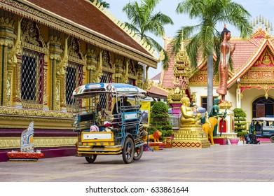 VIENTIANE, LAOS - December 8, 2016: Tuk tuk motorbike taxi in Wat Si Muang Buddhist temple in Vientiane, Laos