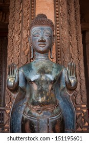 VIENTIANE, LAOS - FEB 12: Bronze Buddha statue at the Haw Phra Kaew, Vientiane, Laos on February 12, 2013.  The Haw Phra Kaew is a former temple, the interior now houses a museum.