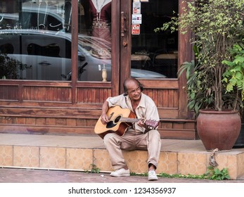 Vientiane, Laos - February 3, 2018: this street musician in Vientane, Laos, played a wonderful blues on his guitar