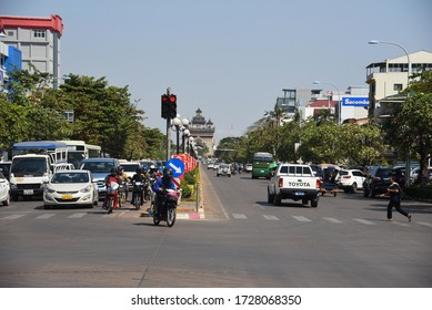 VIENTIANE, LAOS- JANUARY 18, 2019: street scene with view of  Patuxai Monument, on January 18 2019 in Vientiane, Laos