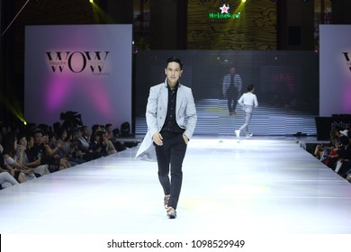 "Vientiane, Laos - May 19, 2018. Beautiful Men Business suit Fashion Models walk on Catwalk to present new collection of ""WOW Fashion Week 2018W"" at Landmark Hotel"