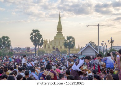 "Vientiane / Laos - November 22 2018: That Luang is the national symbol and most important religious monument of Laos. Vientiane's most important Theravada Buddhist festival, ""Boun That Luang"""